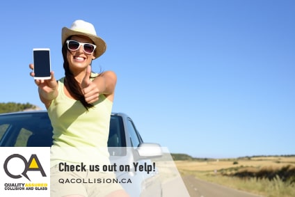 Check us out on Yelp! - Woman giving thumbs up while sitting on the hood of a car
