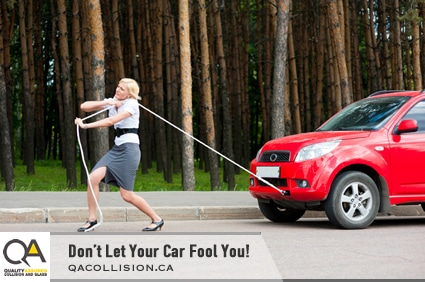 Don't Let Your Car Fool You! - Woman in heels pulling a vehicle with a rope