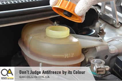 Don't Judge Antifreeze by its Colour - Gloved hand taking cap of antifreeze reservoir