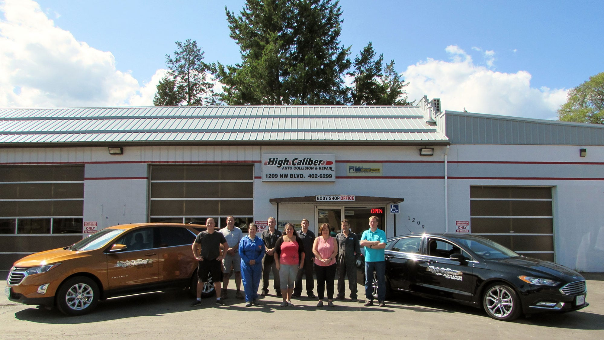 Staff photo outside High Caliber Auto Collision and Repair shop in Creston BC