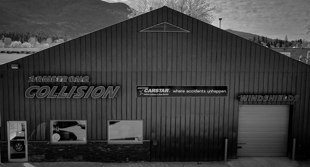 B&W photo of Armstrong Collision building in Armstrong BC